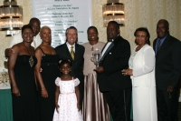 Agatha Delancy surrounded by family & friends & Gary Player