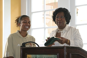 Dr. Thelma B. Thompson, Pres. UMES presents a business card to Langston Jr.