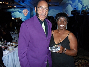 Earl Graves, Chairman, Black Enterprise, receives AAGHOF Induction Award  on behalf of Malachi Knowles, Founder, from Avis Brown-Riley, Chairperson, AAGHOF National Advisory Board