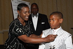 Amari Jaylen Riley, Youth Golfer of the Year-2011, Chulavista, Ca gets pinned with the AAGHOF pin from his mom, Avis L. Brown-Riley.
