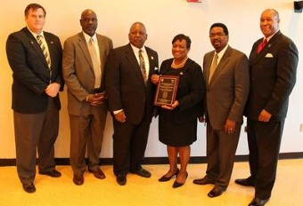 Post Commencement Luncheon, Dr. Juliette B. Bell, President -UMES holding plaque given to them by Founder of the AAGHOF Malachi Knowles.