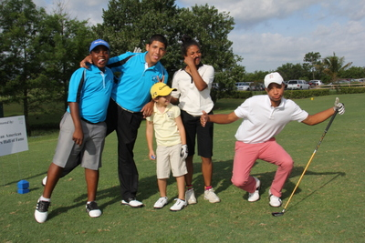 James W. Reede, III far right and Alexandra  Uduk at the Palm Beach Gardens Golf Course with youth from Fore Life organization.